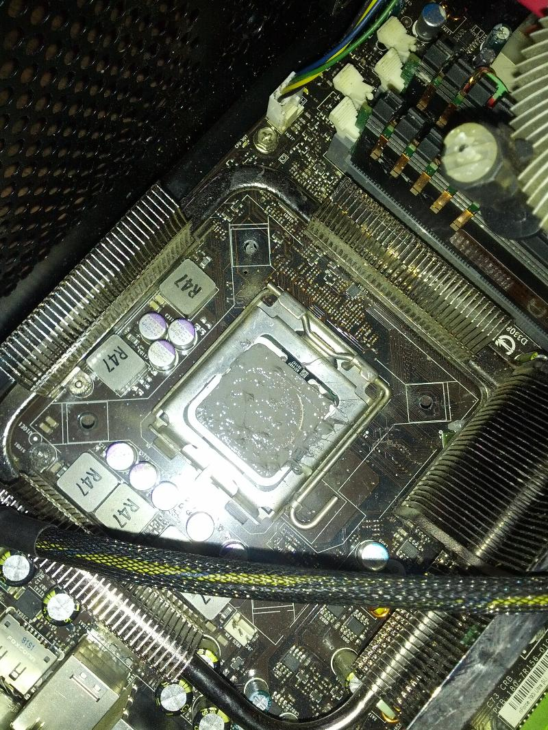 Close up of socket, prior to cleaning off thermal compound
