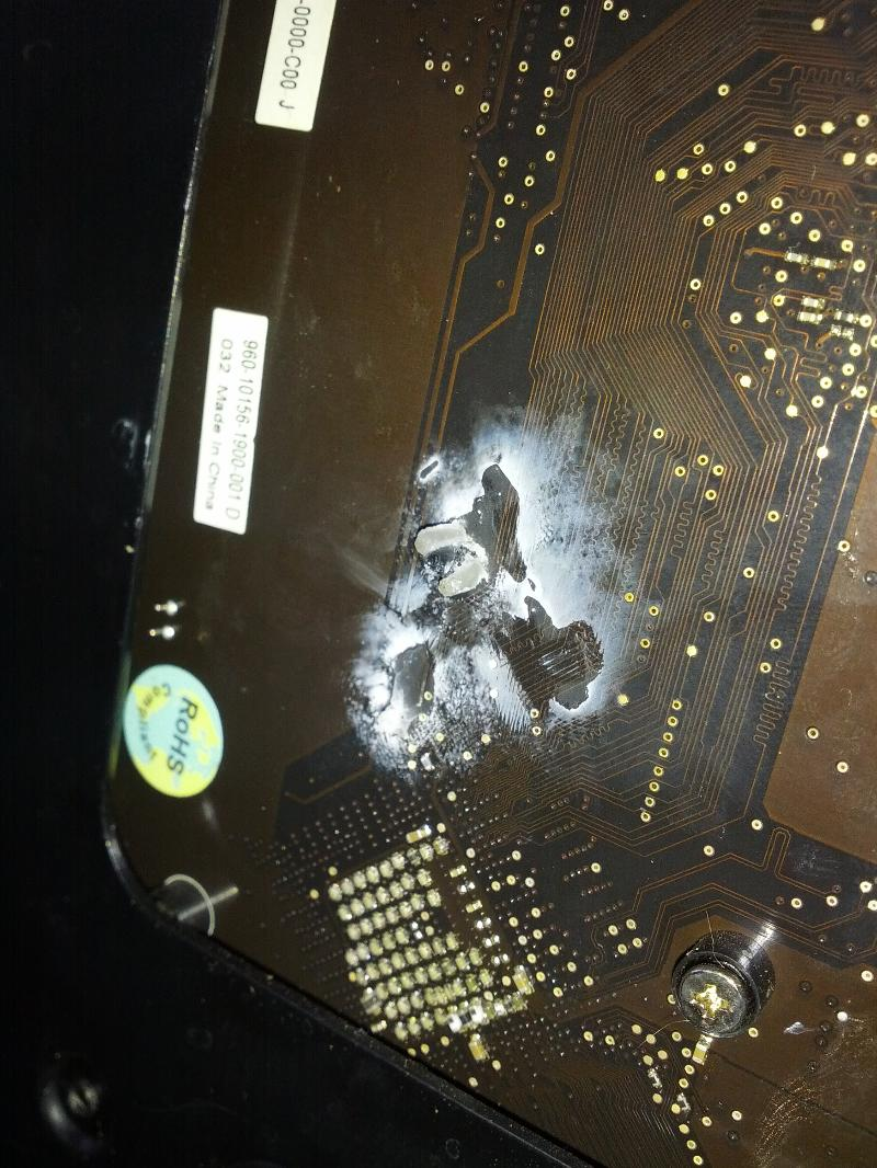 White residue on heat sink mounting hole close-up