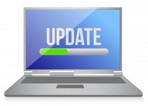 "image of computer with the word ""UPDATE"" on the screen and a bar below indicating update progress"